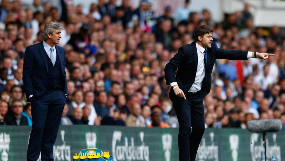 LONDON, ENGLAND - SEPTEMBER 26: Mauricio Pochettino Manager of Tottenham Hotspur gestures with Manuel Pellegrini, manager of Manchester City looks on during the Barclays Premier League match between Tottenham Hotspur and Manchester City at White Hart Lane on September 26, 2015 in London, United Kingdom.  (Photo by Julian Finney/Getty Images)