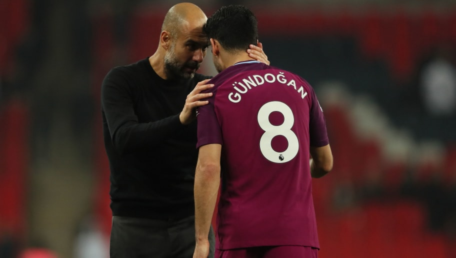 LONDON, ENGLAND - APRIL 14: Manchester City manager Pep Guardiola and Ilkay Gundogan of Manchester City during the Premier League match between Tottenham Hotspur and Manchester City at Wembley Stadium on April 14, 2018 in London, England. (Photo by Matthew Ashton - AMA/Getty Images)