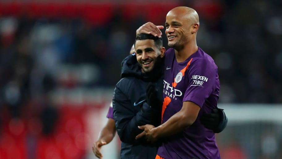 LONDON, ENGLAND - OCTOBER 29:  Riyad Mahrez and Vincent Kompany of Manchester City celebrates victory following the Premier League match between Tottenham Hotspur and Manchester City at Wembley Stadium on October 29, 2018 in London, United Kingdom.  (Photo by Catherine Ivill/Getty Images)