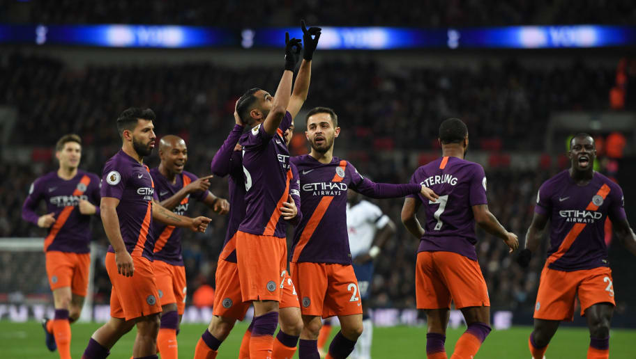 LONDON, ENGLAND - OCTOBER 29: Manchester City's Riyadh Mahrez celebrates with teammates after scoring the opening goal during the Premier League match between Tottenham Hotspur and Manchester City at Tottenham Hotspur Stadium on October 29, 2018 in London, United Kingdom. (Photo by Ashley Western/MB Media/Getty Images)