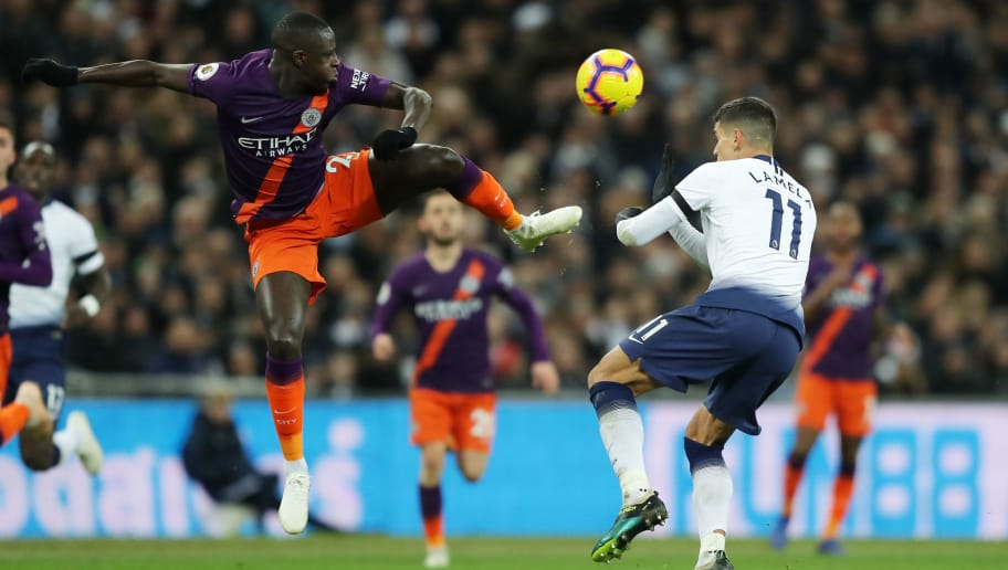 LONDON, ENGLAND - OCTOBER 29:  Benjamin Mendy of Manchester City challenges for the ball with Erik Lamela of Tottenham Hotspur during the Premier League match between Tottenham Hotspur and Manchester City at Wembley Stadium on October 29, 2018 in London, United Kingdom.  (Photo by Richard Heathcote/Getty Images)