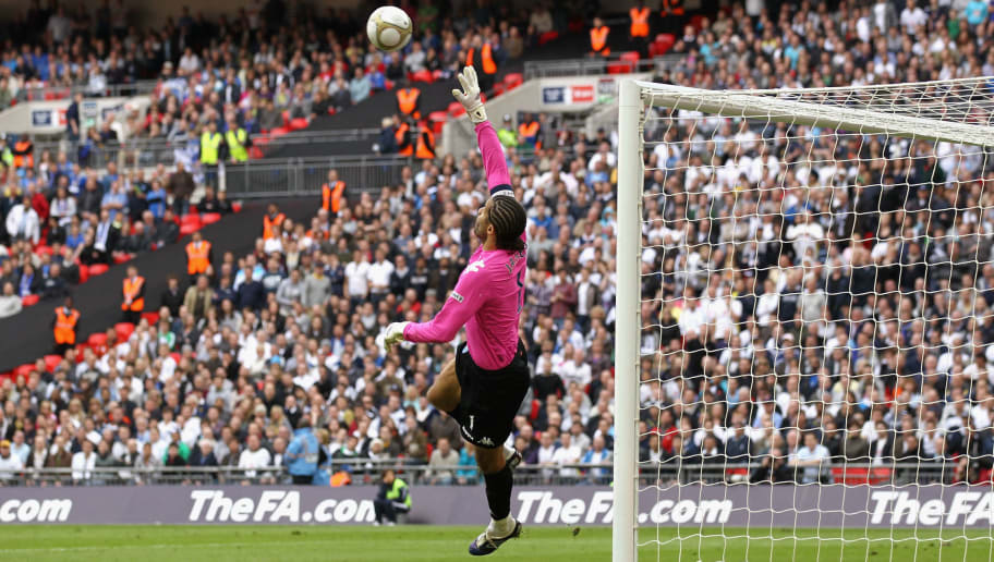 LONDON, ENGLAND - APRIL 11:  Goalkeeper David James of Portsmouth saves the ball during the FA Cup sponsored by E.ON Semi Final match between Tottenham Hotspur and Portsmouth at Wembley Stadium on April 11, 2010 in London, England.  (Photo by Clive Rose/Getty Images)