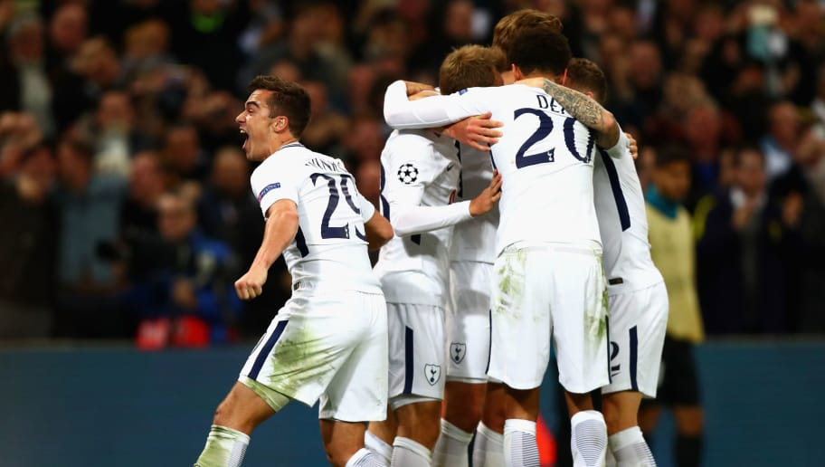 LONDON, ENGLAND - NOVEMBER 01:  Christian Eriksen of Tottenham Hotspur celebrates scoring his side's third goal with team mates during the UEFA Champions League group H match between Tottenham Hotspur and Real Madrid at Wembley Stadium on November 1, 2017 in London, United Kingdom.  (Photo by Clive Rose/Getty Images)
