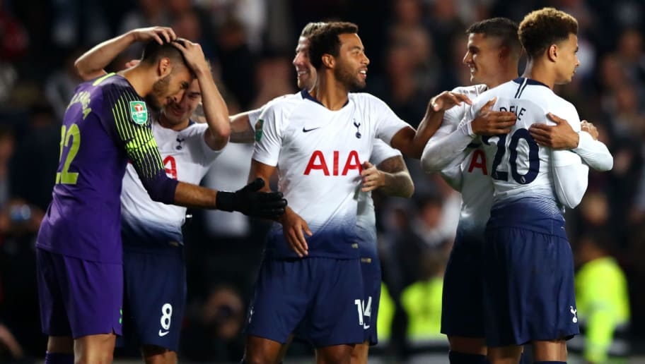 MILTON KEYNES, ENGLAND - SEPTEMBER 26:  Paulo Gazzaniga of Tottenham Hotspur in congratulated by teammates after the penalty shoot out during the Carabao Cup Third Round match between Tottenham Hotspur and Watford at Stadium mk on September 26, 2018 in Milton Keynes, England.  (Photo by Matthew Lewis/Getty Images)