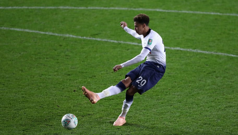 MILTON KEYNES, ENGLAND - SEPTEMBER 26:  Dele Alli of Tottenham Hotspur scores their final penalty in their victory on penalties during the Carabao Cup Third Round match between Tottenham Hotspur and Watford at Stadium mk on September 26, 2018 in Milton Keynes, England.  (Photo by David Rogers/Getty Images)