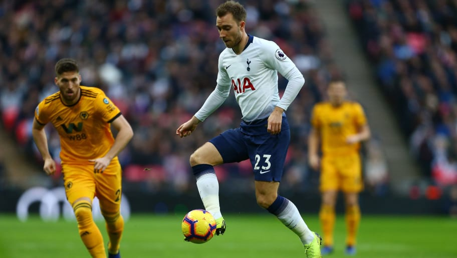 LONDON, ENGLAND - DECEMBER 29:  Christian Eriksen of Tottenham Hotspur battles for possession with Matt Doherty of Wolverhampton Wanderers during the Premier League match between Tottenham Hotspur and Wolverhampton Wanderers at Tottenham Hotspur Stadium on December 29, 2018 in London, United Kingdom.  (Photo by Jordan Mansfield/Getty Images)