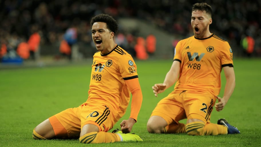 LONDON, ENGLAND - DECEMBER 29:  Helder Costa of Wolverhampton Wanderers celebrates with his teammate Matt Doherty of Wolverhampton Wanderers after scoring their third goal during the Premier League match between Tottenham Hotspur and Wolverhampton Wanderers at Tottenham Hotspur Stadium on December 29, 2018 in London, United Kingdom.  (Photo by Marc Atkins/Getty Images)