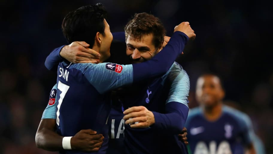 BIRKENHEAD, ENGLAND - JANUARY 04:  Fernando Llorente of Tottenham Hotspur celebrates with team mate Heung-Min Son after scoring their team's second goal  during the FA Cup Third Round match between Tranmere Rovers and Tottenham Hotspur at Prenton Park on January 4, 2019 in Birkenhead, United Kingdom.  (Photo by Clive Brunskill/Getty Images)