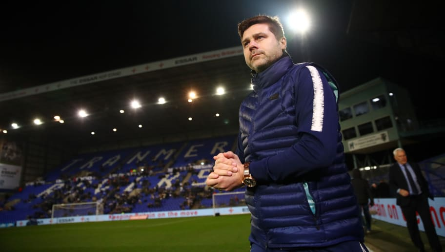 BIRKENHEAD, ENGLAND - JANUARY 04:  Mauricio Pochettino, Manager of Tottenham Hotspur looks on as he inspects the pitch prior to the FA Cup Third Round match between Tranmere Rovers and Tottenham Hotspur at Prenton Park on January 4, 2019 in Birkenhead, United Kingdom.  (Photo by Clive Brunskill/Getty Images)