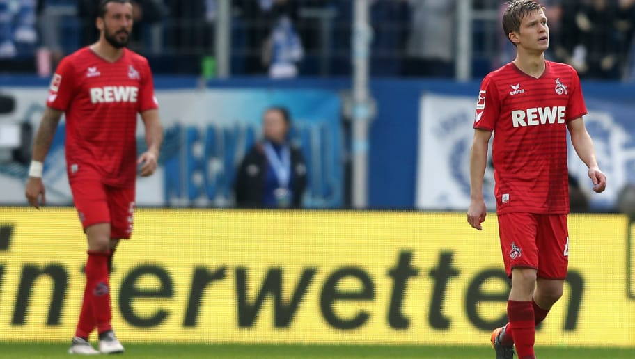 SINSHEIM, GERMANY - MARCH 31: (L-R) Dominic Maroh and Vincent Koziello of Koeln look dejected after the second goal of Hoffenheim during the Bundesliga match between TSG 1899 Hoffenheim and 1. FC Koeln at Wirsol Rhein-Neckar-Arena on March 31, 2018 in Sinsheim, Germany.