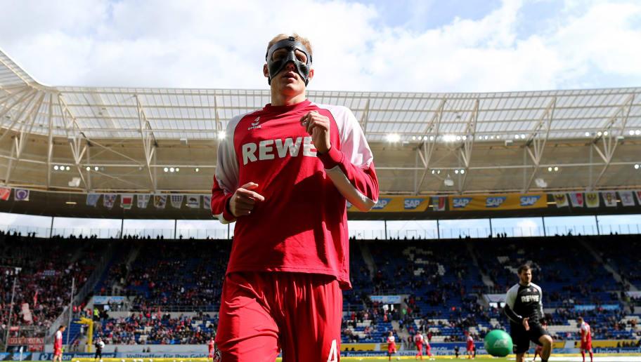 SINSHEIM, GERMANY - MARCH 31: Frederik Soerensen of Koeln warms up with a face mask prior to the Bundesliga match between TSG 1899 Hoffenheim and 1. FC Koeln at Wirsol Rhein-Neckar-Arena on March 31, 2018 in Sinsheim, Germany.