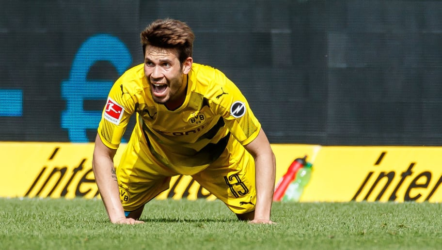 SINSHEIM, GERMANY - MAY 12: Raphael Guerreiro of Dortmund on the ground during the Bundesliga match between TSG 1899 Hoffenheim and Borussia Dortmund at Wirsol Rhein-Neckar-Arena on May 12, 2018 in Sinsheim, Germany. (Photo by TF-Images/Getty Images)