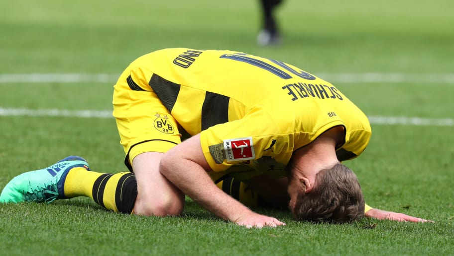 SINSHEIM, GERMANY - MAY 12: Andre Schuerrle of Dortmund reacts on the ground during the Bundesliga match between TSG 1899 Hoffenheim and Borussia Dortmund at Wirsol Rhein-Neckar-Arena on May 12, 2018 in Sinsheim, Germany. (Photo by TF-Images/Getty Images)