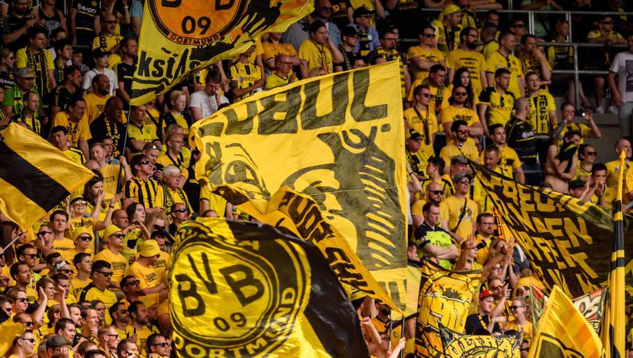SINSHEIM, GERMANY - MAY 12: Fans of Dortmund are seen during the Bundesliga match between TSG 1899 Hoffenheim and Borussia Dortmund at Wirsol Rhein-Neckar-Arena on May 12, 2018 in Sinsheim, Germany. (Photo by Alexander Scheuber/Bongarts/Getty Images)