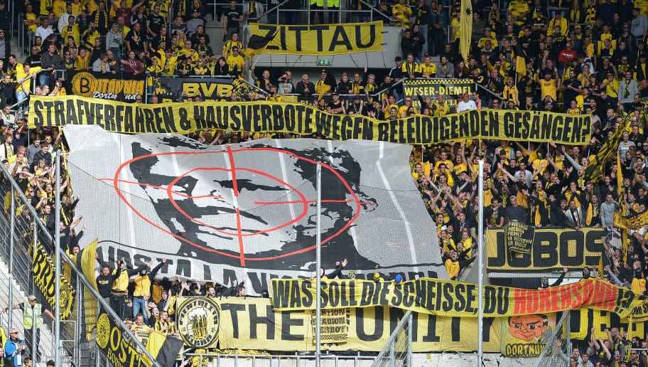 SINSHEIM, GERMANY - SEPTEMBER 22: Supporters of Borussia Dortmund are seen with banners against Dietmar Hopp during the Bundesliga match between TSG 1899 Hoffenheim and Borussia Dortmund at Wirsol Rhein-Neckar-Arena on September 22, 2018 in Sinsheim, Germany. (Photo by TF-Images/Getty Images)