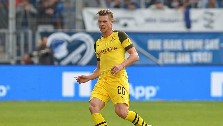 SINSHEIM, GERMANY - SEPTEMBER 22: Lukasz Piszczek of Borussia Dortmund controls the ball during the Bundesliga match between TSG 1899 Hoffenheim and Borussia Dortmund at Wirsol Rhein-Neckar-Arena on September 22, 2018 in Sinsheim, Germany. (Photo by TF-Images/Getty Images)
