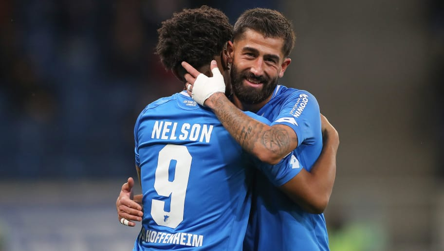 SINSHEIM, GERMANY - NOVEMBER 10: Reiss Nelson of TSG 1899 Hoffenheim celebrates  his team`s second goal with his teammate Kerem Demirbay of TSG 1899 Hoffenheim during the Bundesliga match between TSG 1899 Hoffenheim and FC Augsburg at Wirsol Rhein-Neckar-Arena on November 10, 2018 in Sinsheim, Germany. (Photo by Christian Kaspar-Bartke/Bongarts/Getty Images)