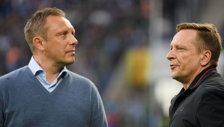 SINSHEIM, GERMANY - APRIL 27: Head coach Andre Breitenreiter and sporting director Horst Heldt of Hannover look on prior to the Bundesliga match between TSG 1899 Hoffenheim and Hannover 96 at Wirsol Rhein-Neckar-Arena on April 27, 2018 in Sinsheim, Germany. (Photo by Matthias Hangst/Bongarts/Getty Images)