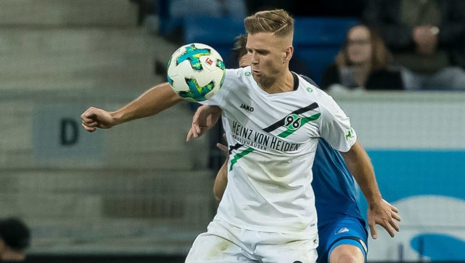 SINSHEIM, GERMANY - APRIL 27: Niclas Fuellkrug of Hannover and Ermin Bicakcic of Hoffenheim battle for the ball during the Bundesliga match between TSG 1899 Hoffenheim and Hannover 96 at Wirsol Rhein-Neckar-Arena on April 27, 2018 in Sinsheim, Germany. (Photo by TF-Images/Getty Images)