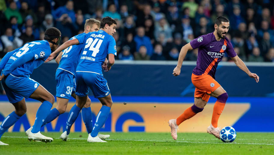 SINSHEIM, GERMANY - OCTOBER 02: Ilkay Guendogan of Manchester City is challenged by Justin Hoogma, Stefan Posch and Kevin Akpoguma of Hoffenheim during the Group F match of the UEFA Champions League between TSG 1899 Hoffenheim and Manchester City at Wirsol Rhein-Neckar-Arena on October 2, 2018 in Sinsheim, Germany. (Photo by Simon Hofmann/Getty Images)