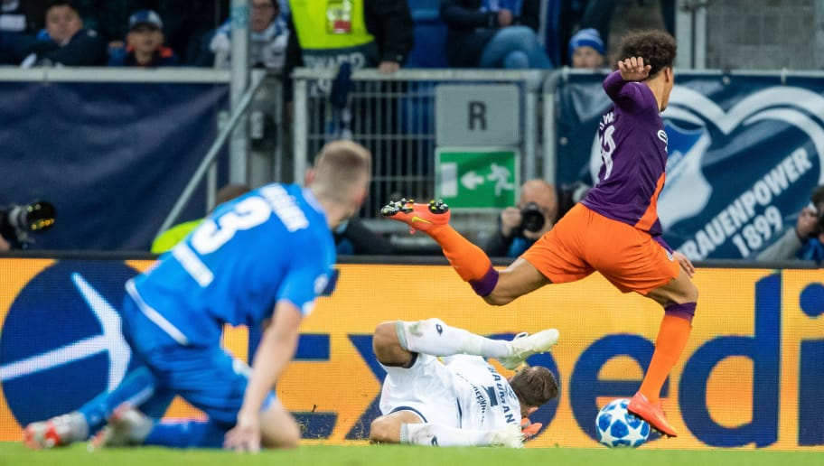 SINSHEIM, GERMANY - OCTOBER 02: Leroy Sane of Manchester City is challenged by goalkeeper Oliver Baumann of Hoffenheim during the Group F match of the UEFA Champions League between TSG 1899 Hoffenheim and Manchester City at Wirsol Rhein-Neckar-Arena on October 2, 2018 in Sinsheim, Germany. (Photo by Simon Hofmann/Getty Images)