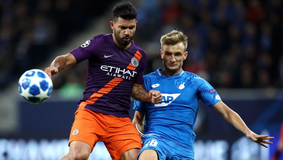 SINSHEIM, GERMANY - OCTOBER 02:  Sergio Aguero of Manchester City is challenged by Stefan Posch of 1899 Hoffenheim during the Group F match of the UEFA Champions League between TSG 1899 Hoffenheim and Manchester City at Wirsol Rhein-Neckar-Arena on October 2, 2018 in Sinsheim, Germany.  (Photo by Maja Hitij/Bongarts/Getty Images)
