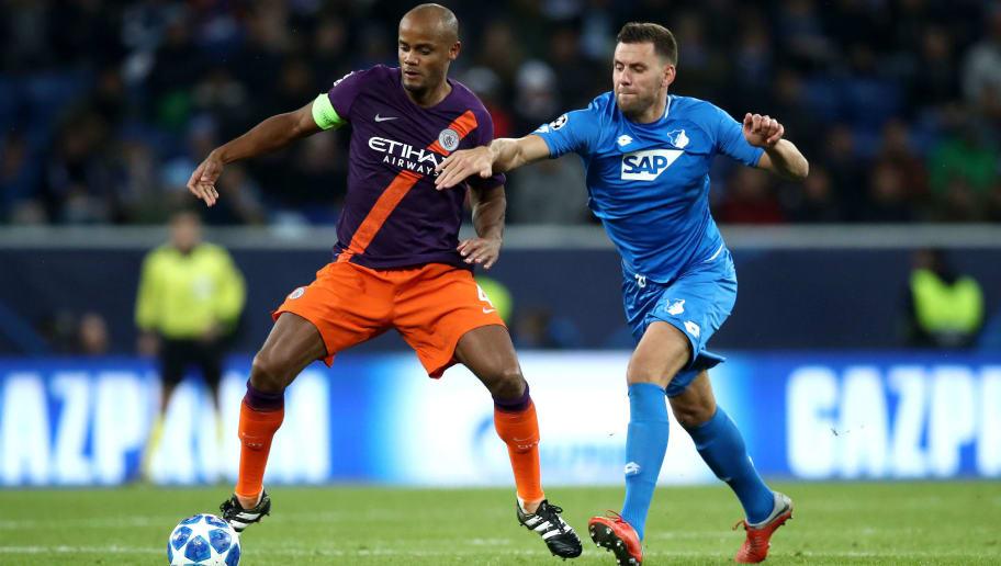 SINSHEIM, GERMANY - OCTOBER 02:  Vincent Kompany of Manchester City is challenged by Adam Szalai of 1899 Hoffenheim during the Group F match of the UEFA Champions League between TSG 1899 Hoffenheim and Manchester City at Wirsol Rhein-Neckar-Arena on October 2, 2018 in Sinsheim, Germany.  (Photo by Maja Hitij/Bongarts/Getty Images)