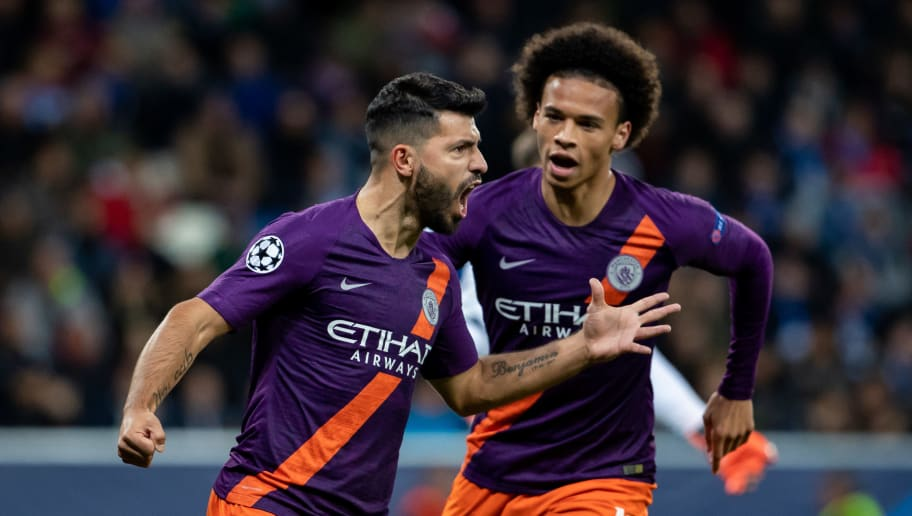 SINSHEIM, GERMANY - OCTOBER 02: Sergio Aguero of Manchester City celebrates his team's first goal with team mate Leroy Sane (R) during the Group F match of the UEFA Champions League between TSG 1899 Hoffenheim and Manchester City at Wirsol Rhein-Neckar-Arena on October 2, 2018 in Sinsheim, Germany. (Photo by Simon Hofmann/Getty Images)