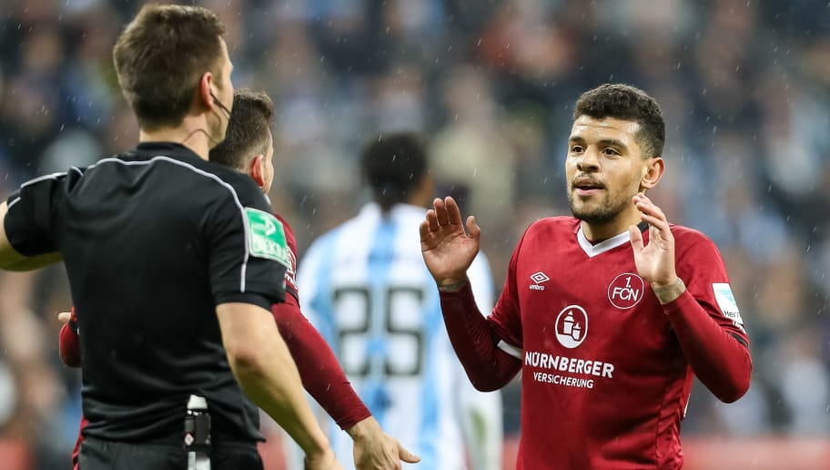 MUNICH, GERMANY - FEBRUARY 20: Shawn Parker of 1. FC Nuernberg speak with Referee Frank Willenborg during the Second Bundesliga match between TSV 1860 Muenchen and 1. FC Nuernberg at Allianz Arena on February 20, 2017 in Munich, Germany. (Photo by TF-Images/Getty Images)