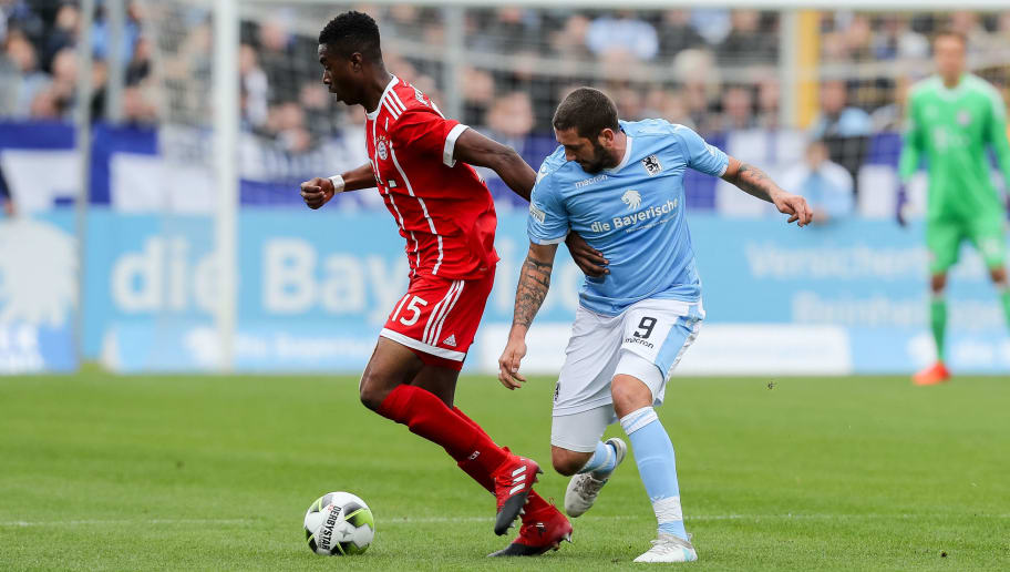 MUNICH, GERMANY - OCTOBER 22: Maxime Awoudja of Bayern Muenchen and Sascha Moelders of 1860 Muenchen battle for the ball during the match between TSV 1860 Muenchen and Bayern Muenchen II at Stadion an der Grünwalder Straße on October 22, 2017 in Munich, Germany. (Photo by TF-Images/TF-Images via Getty Images)