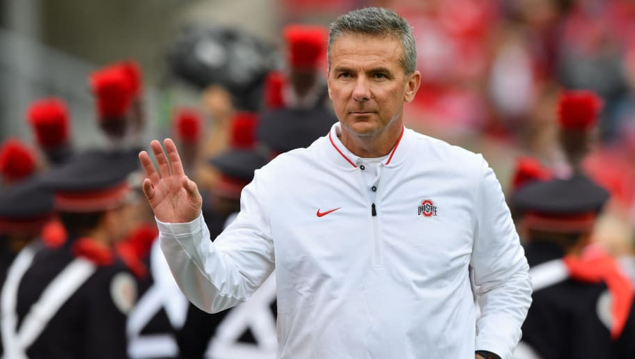 COLUMBUS, OH - SEPTEMBER 22:  Head Coach Urban Meyer of the Ohio State Buckeyes leads his team in warm ups before a game against the Tulane Green Wave at Ohio Stadium on September 22, 2018 in Columbus, Ohio.  (Photo by Jamie Sabau/Getty Images)