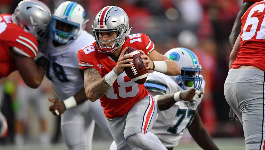 COLUMBUS, OH - SEPTEMBER 22:  Quarterback Tate Martell #18 of the Ohio State Buckeyes runs with the ball against the Tulane Green Wave at Ohio Stadium on September 22, 2018 in Columbus, Ohio.  (Photo by Jamie Sabau/Getty Images)