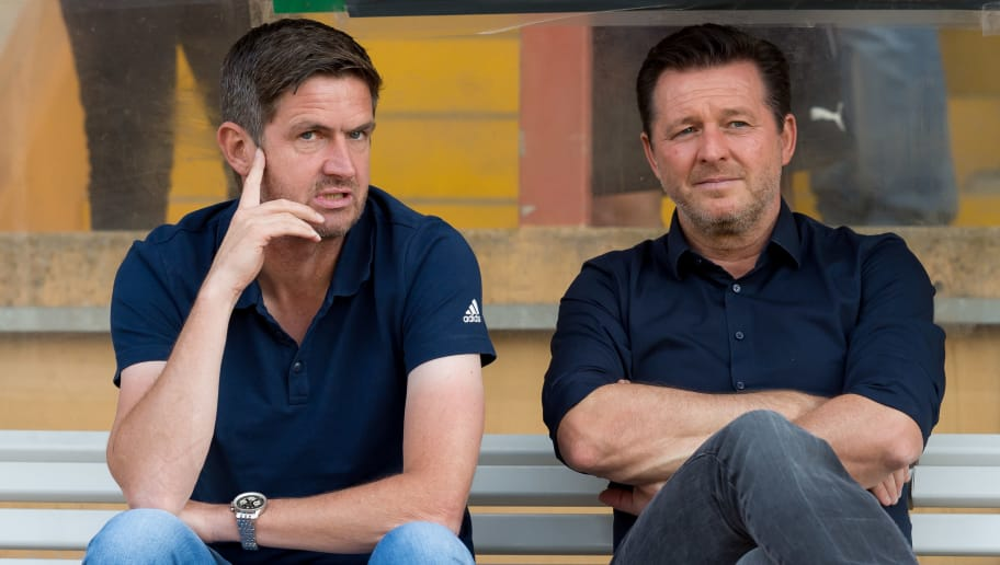 SIEGEN, GERMANY - AUGUST 18: Board of sports Ralf Becker of Hamburger SV speaks with Head coach Christian Titz of Hamburger SV prior to the DFB Cup first round match between TuS Erndtebrueck and Hamburger SV at Leimbachstadion on August 18, 2018 in Siegen, Germany. (Photo by TF-Images/Getty Images)
