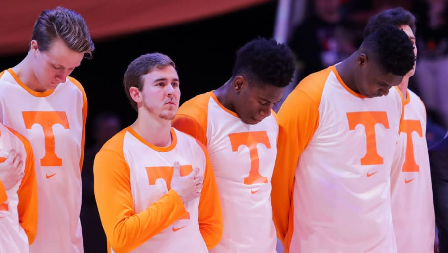 KNOXVILLE, TN - OCTOBER 31: Zach Kent #33, Brad Woodson #12, Admiral Schofield #5, and D.J. Burns #32 of the Tennessee Volunteers during the National Anthem before the game between the Tusculum Pioneers and the Tennessee Volunteers at Thompson-Boling Arena on October 31, 2018 in Knoxville, Tennessee. (Photo by Donald Page/Getty Images)