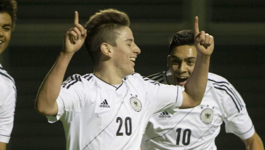 SHEFAYIM, ISRAEL - DECEMBER 16: Aaron Sydel (L) Nicolas Sessa (C) and Nadiem Amiri of  Germany celebrate after a goal during the Under 18 International Friendly match between Moldova and Germany on December 16, 2013 in Shefayim, Israel.  (Photo by Lior Mizrahi/Bongarts/Getty Images)