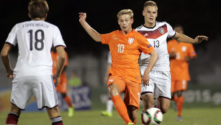 KATERINI, GREECE - JULY 10: Max Christiansen of Germany competes with Frenkie De Jong of Netherlands during the UEFA U-19 Championship 2015 final tournament match between Netherlands vs Germany on July 10 , 2015 in Katerini , Greece (Photo by Milos Bicanski/Getty Images)