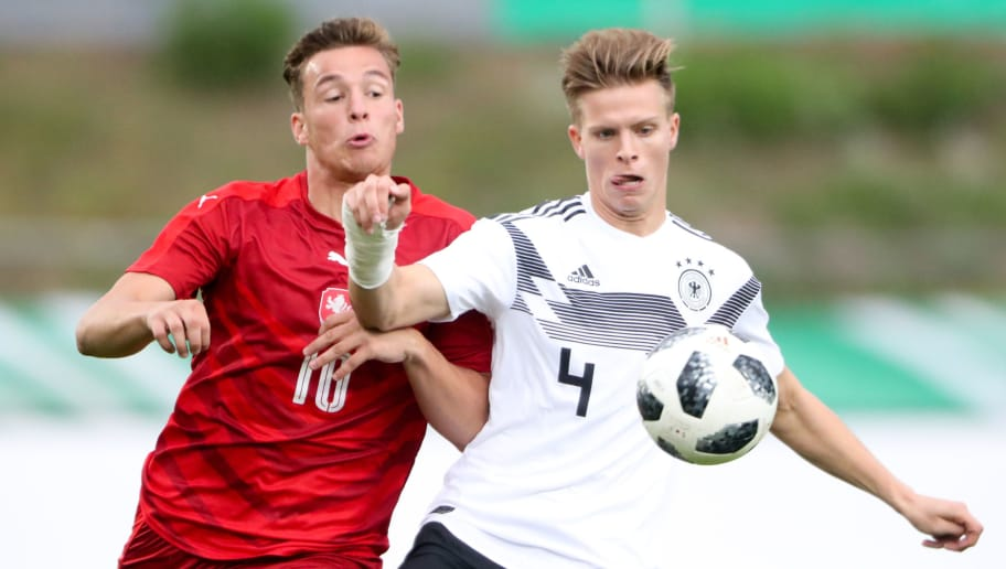 NEUNKIRCHEN, GERMANY - SEPTEMBER 07: Dzenis Burnic of U20 Germany challenges Ondej Sasinka of Czech Republic during the U20 friendly match between Germany and Czech Republic on September 7, 2018 in Elversberg, Germany. (Photo by Andreas Schlichter/Bongarts/Getty Images)