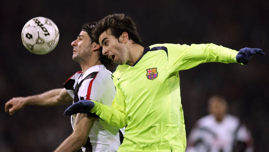 Udine, ITALY:  Udinese's forward Vincenzo Iaquinta (L) vies for the ball with FC Barcelona's defender Oleguer during their first leg group C Champions League football match at Friuli stadium in Udine, 07 December 2005.  AFP PHOTO / PACO SERINELLI  (Photo credit should read PACO SERINELLI/AFP/Getty Images)