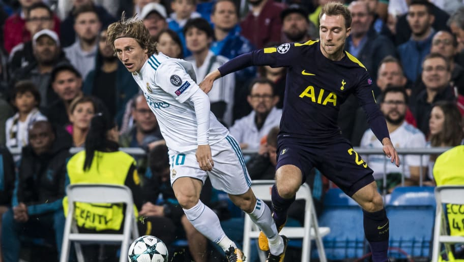 MADRID, SPAIN - OCTOBER 17: Luka Modric of Real Madrid  (L) fights for the ball with Christian Eriksen of Tottenham Hotspur FC (R) during the UEFA Champions League 2017-18 match between Real Madrid and Tottenham Hotspur FC at Estadio Santiago Bernabeu on 17 October 2017 in Madrid, Spain. (Photo by Power Sport Images/Getty Images)