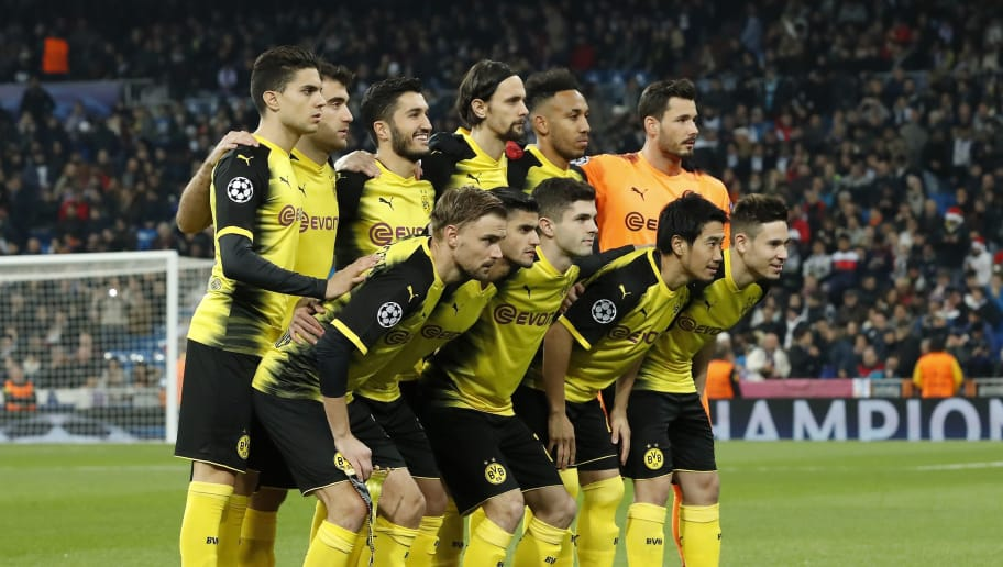 (Top Row L-R) Marc Bartra of Borussia Dortmund, Sokratis Papastathopoulos of Borussia Dortmund, Nuri Sahin of Borussia Dortmund, Neven Subotic of Borussia Dortmund, Pierre-Emerick Aubameyang of Borussia Dortmund, goalkeeper Roman Burki of Borussia Dortmund  (Front row L-R) Marcel Schmelzer of Borussia Dortmund, Mahmoud Dahoud of Borussia Dortmund, Christian Pulisic of Borussia Dortmund, Shinji Kagawa of Borussia Dortmund, Raphael Guerreiro of Borussia Dortmund during the UEFA Champions League group H match between Real Madrid and Borussia Dortmund on December 06, 2017 at the Santiago Bernabeu stadium in Madrid, Spain.(Photo by VI Images via Getty Images)