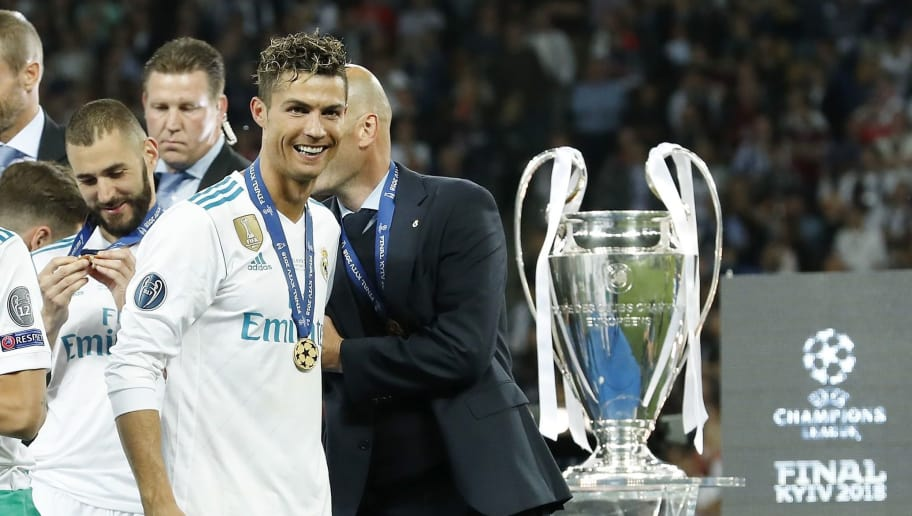 (L-R) Karim Benzema of Real Madrid, Cristiano Ronaldo of Real Madrid, coach Zinedine Zidane of Real Madrid during the UEFA Champions League final between Real Madrid and Liverpool on May 26, 2018 at NSC Olimpiyskiy Stadium in Kyiv, Ukraine(Photo by VI Images via Getty Images)