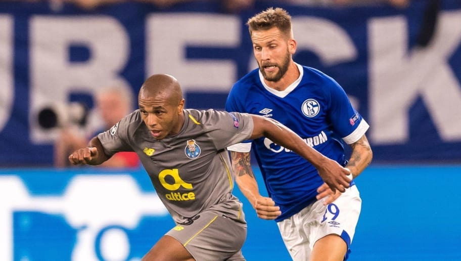 (L-R) Yacine Brahimi of FC Porto, Guido Burgstaller of FC Schalke 04 DFL REGULATIONS PROHIBIT ANY USE OF PHOTOGRAPHS AS IMAGE SEQUENCES AND/OR QUASI-VIDEO. during the UEFA Champions League group D match between Schalke 04 and FC Porto at the Arena auf Schalke on September 18, 2018 in Gelschenkirchen, Germany(Photo by VI Images via Getty Images)