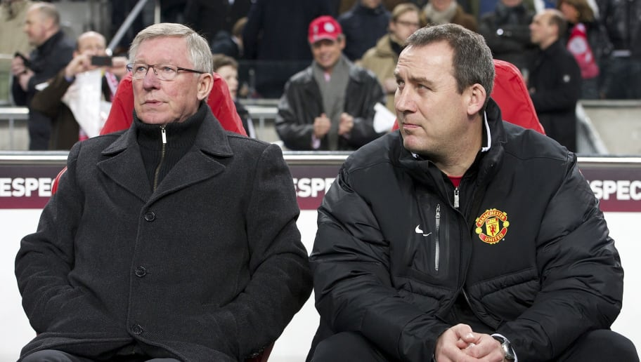 (L-R) Sir Alex Ferguson of Manchester United,Rene Meulensteen of Manchester United during the UEFA Europa League round of 32 match between AFC Ajax and Manchester United FC at the Amsterdam Arena on February 16, 2012 in Amsterdam, Netherlands. (Photo by VI Images via Getty Images)