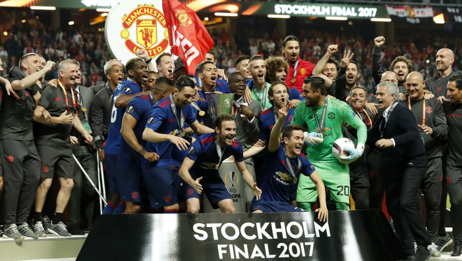 (L-R) Jesse Lingard of Manchester United, Paul Pogba of Manchester United, Chris Smalling of Manchester United, Juan Mata of Manchester United, Wayne Rooney of Manchester United, Antonio Valencia of Manchester United, Zlatan Ibrahimovic of Manchester United goalkeeper David de Gea of Manchester United, Ander Herrera of Manchester United, Daley Blind of Manchester United, goalkeeper Sergio Romero of Manchester United, coach Jose Mourinho of Manchester United with the Coupe UEFA, the UEFA cup, the Europa League trophyduring the UEFA Europa League final match between Ajax Amsterdam and Manchester United at the Friends Arena on May 24, 2017 in Stockholm, Sweden(Photo by VI Images via Getty Images)