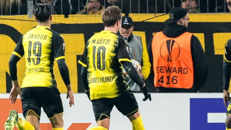 (L-R) Mahmoud Dahoud of Borussia Dortmund, Mario Gotze of Borussia Dortmund, Michy Batshuayi of Borussia Dortmund during the UEFA Europa League round of 32 match between Borussia Dortmund and Atalanta Bergamo at the Signal Iduna Park stadium on February 14, 2018 in Dortmund, Germany.(Photo by VI Images via Getty Images)