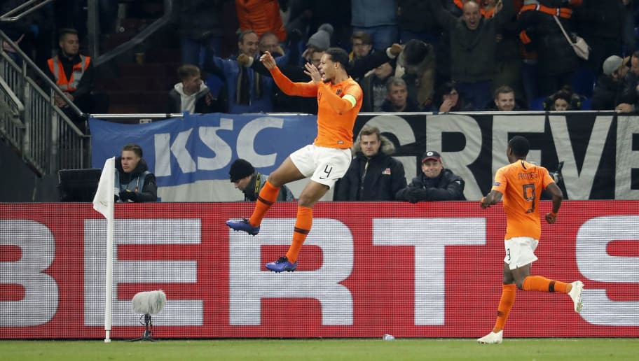(L-R) Virgil van Dijk of Holland, Quincy Promes of Holland during the UEFA Nations League A group 1 qualifying match between Germany and The Netherlands at the Veltins Arena on November 19, 2018 in Gelsenkirchen, Germany(Photo by VI Images via Getty Images)