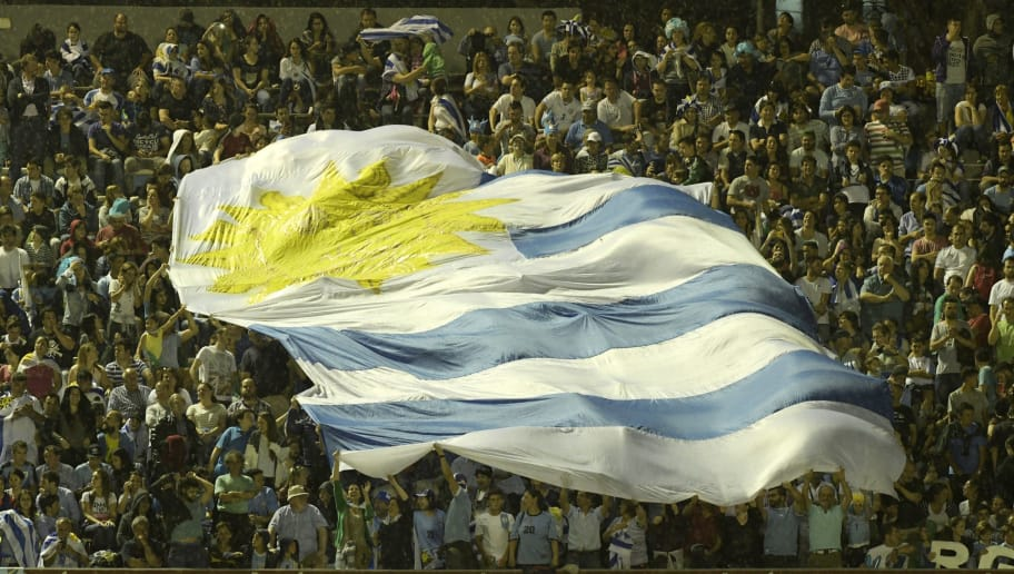 MONTEVIDEO, URUGUAY - NOVEMBER 10:  Fans of Uruguay display a giant Uruguayan flag during a match between Uruguay and Ecuador as part of FIFA 2018 World Cup Qualifiers at  Centenario Stadium on November 10, 2016 in Montevideo, Uruguay. (Photo by Sandro Pereyra/LatinContent/Getty Images)