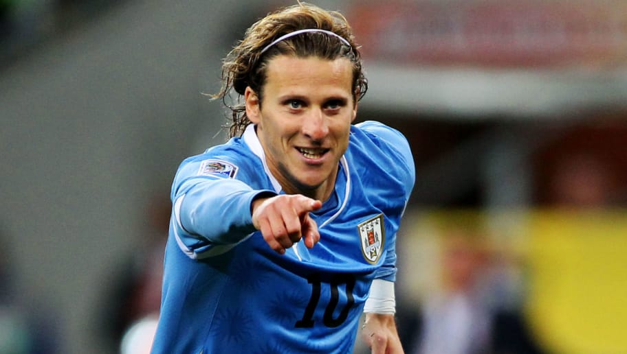 PORT ELIZABETH, SOUTH AFRICA - JULY 10:  Diego Forlan of Uruguay celebrates scoring his team's second goal during the 2010 FIFA World Cup South Africa Third Place Play-off match between Uruguay and Germany at The Nelson Mandela Bay Stadium on July 10, 2010 in Port Elizabeth, South Africa.  (Photo by Joern Pollex/Getty Images)