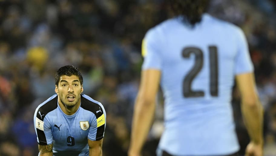 MONTEVIDEO, URUGUAY - SEPTEMBER 06:  Luis Suarez of Uruguay looks at his teammate Edinson Cavani during a match between Uruguay and Paraguay as part of FIFA 2018 World Cup Qualifiers at Centenario Stadium on September 06, 2016 in Montevideo, Uruguay. (Photo by Sandro Pereyra/LatinContent/Getty Images)