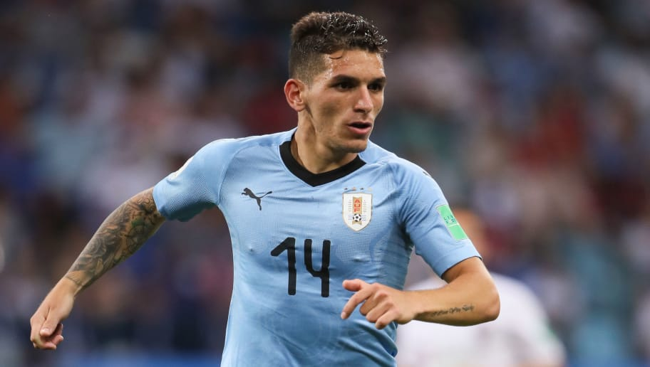 SOCHI, RUSSIA - JUNE 30:   Lucas Torreira of Uruguay in action during the 2018 FIFA World Cup Russia Round of 16 match between Uruguay and Portugal at Fisht Stadium on June 30, 2018 in Sochi, Russia. (Photo by Matthew Ashton - AMA/Getty Images)